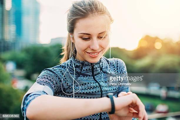Sportswoman checking her smart watch