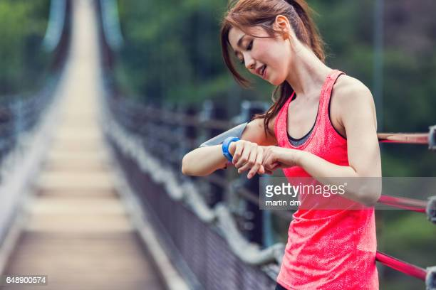 Sportswoman checking pulse
