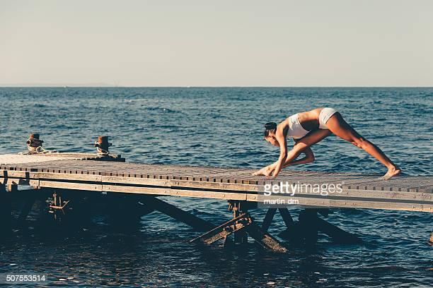 Sportswoman exercising at the quay
