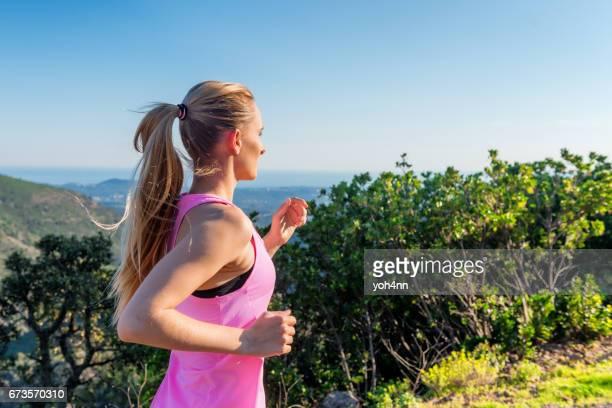 Sportswoman running outdoors