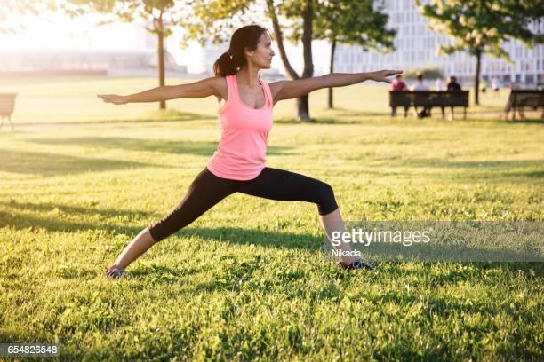 sportswoman stretching before the run