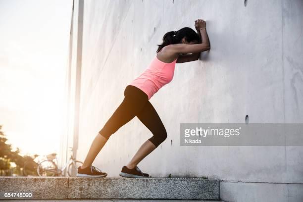 sportswoman stretching