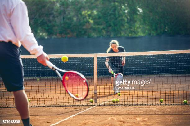 Sportswoman Training Tennis With Tennis Instruction