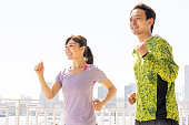 sporty asian people jogging