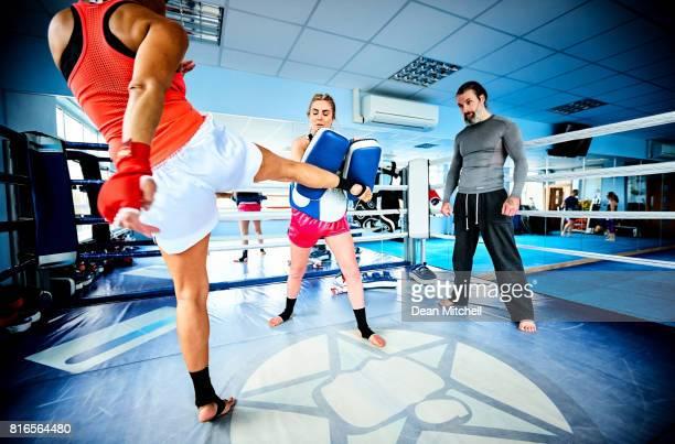 Sporty females doing kickboxing training