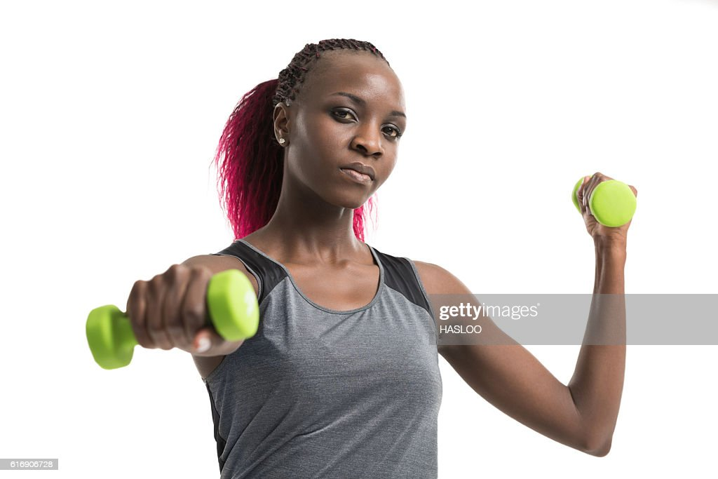 Sporty girl holding weights : Stock Photo