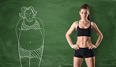 Sporty girl with a slim body standing at the right side and a picture of a fat woman drawn at the left side on a green chalkboard background. Getting rid of a pot belly. Losing weight. Before and afte