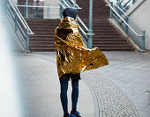 sporty man wrapping himself in a space blanket