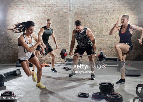 sporty people  practicing with weights : Stock Photo