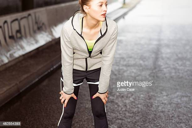 sporty woman catching I her breath after running