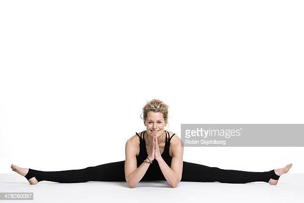 Sporty woman doing the splits
