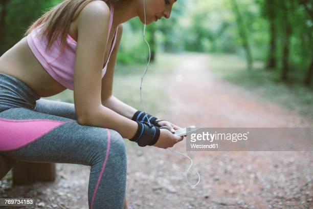Sporty woman having a break in forest