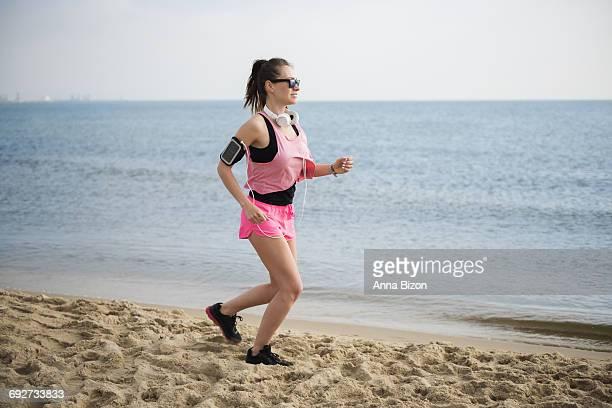 Sporty woman on the beach. Gdansk, Poland