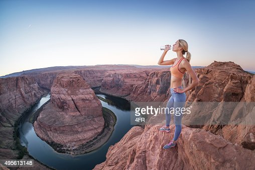 Sporty Woman refreshing, drinking Water at Horseshoe Bend