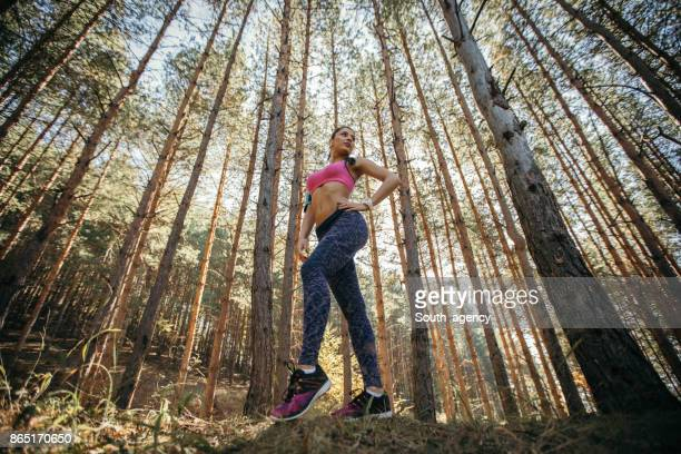 Sporty woman standing in autumn nature