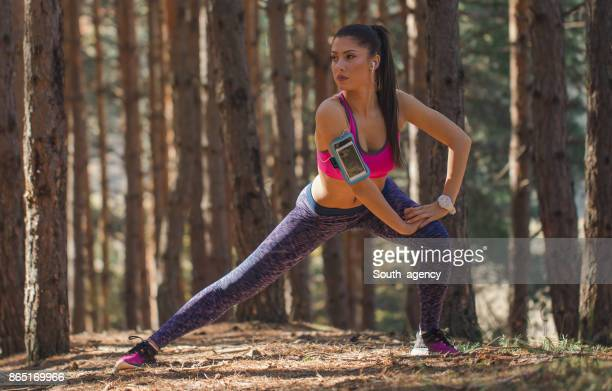 Sporty woman stretching in nature