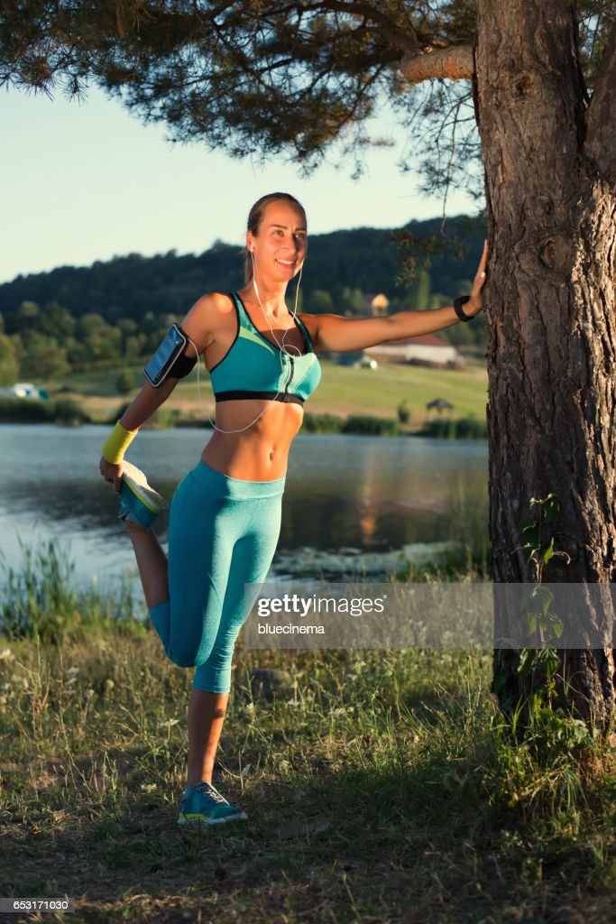 Sporty Woman Stretching Legs : Stock Photo