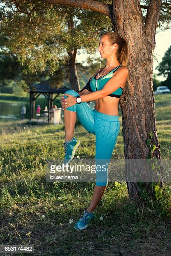Sporty Woman Stretching Legs : Stock-Foto