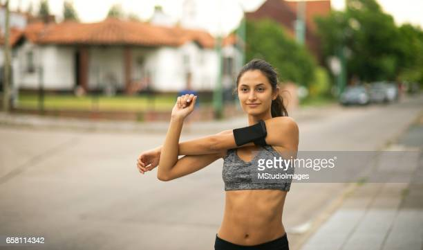 Sporty woman stretching.
