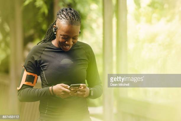Sporty woman using mobile phone after workout