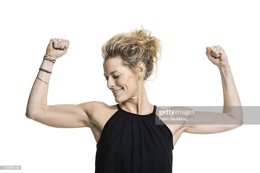 Sporty woman with arms in the air smiling : Stock Photo