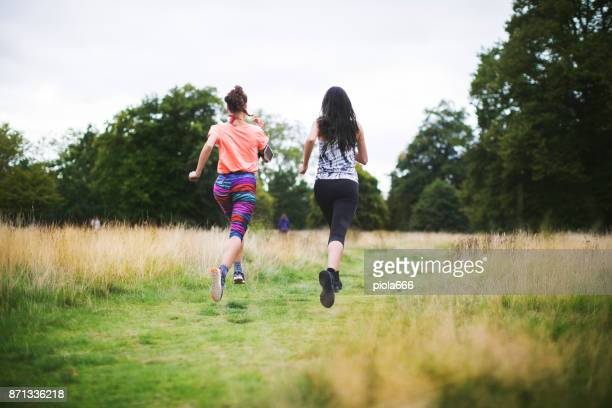 Sporty women running together