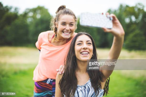 Sporty women selfie on mobile after running
