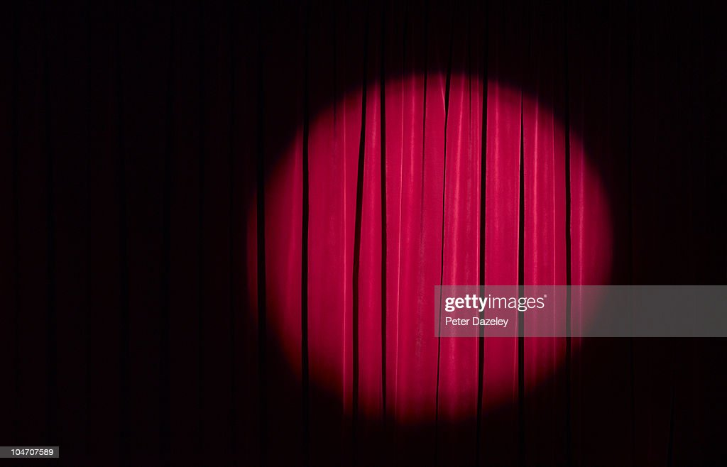 Spot light on red theatre curtains