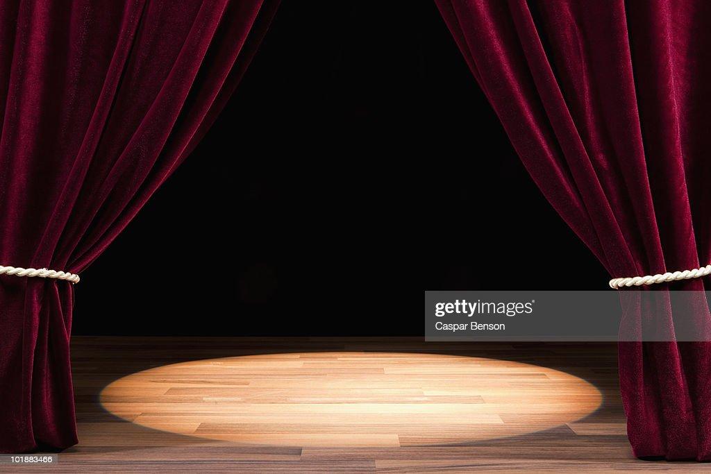 A Spot Lit Empty Theatre Stage