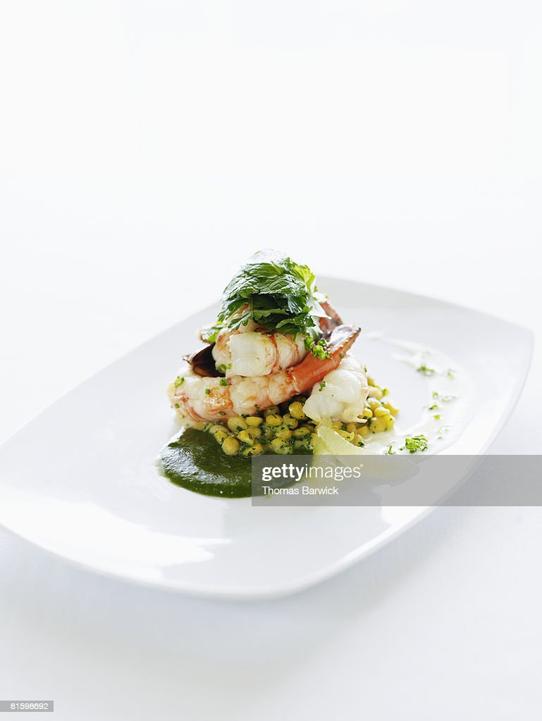 Spot prawns with chickpeas, herb coulis and meyer lemon.