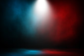 Spotlight fight and match red and blue smoke background.