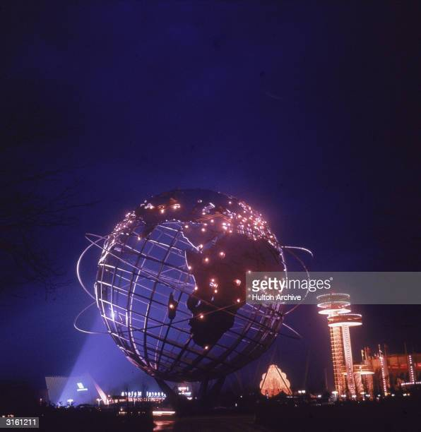 A spotlight illuminates the unisphere steel globe at the World's Fair Flushing Meadow Queens New York 1964