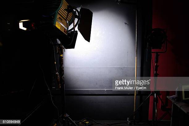 Spotlight in dark studio