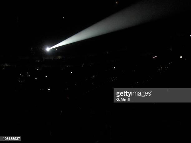 Spotlight in front of massive crowd
