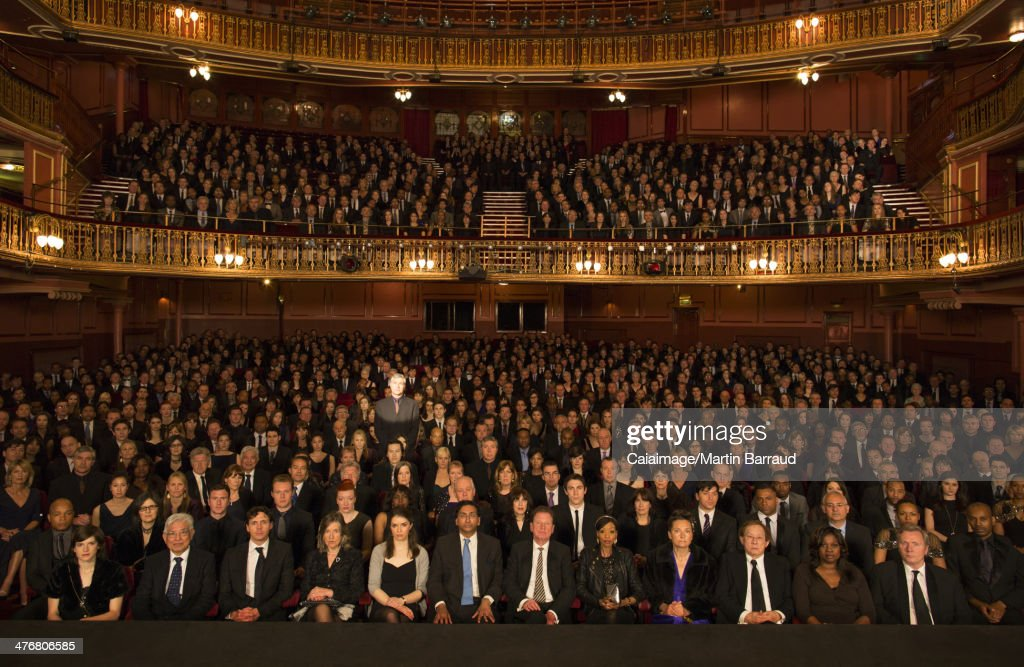Spotlight on audience member in theater : Stock Photo