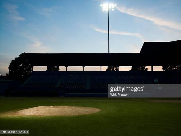 Spotlight on pitcher's mound on baseball field