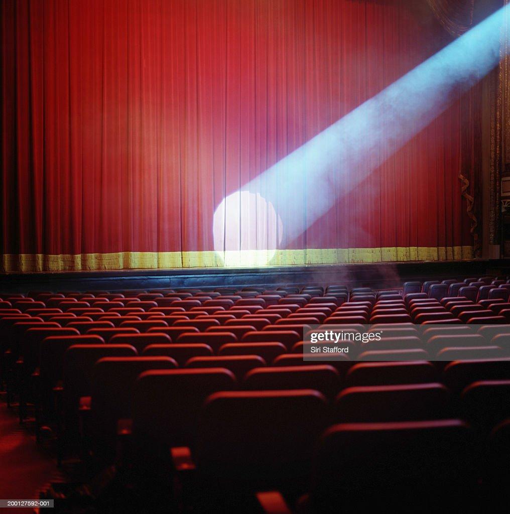 Spotlight on red theater curtain