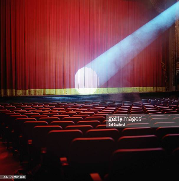 Spotlight on red theater curtain