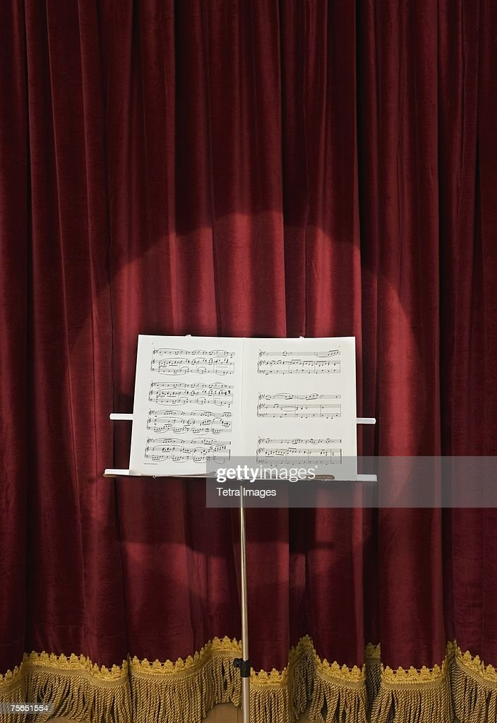 Spotlight on sheet music on stage