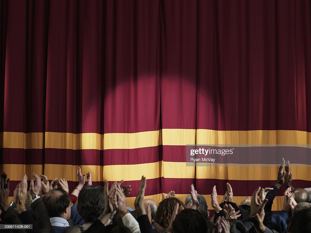 Stage curtains spotlight - Spotlight On Stage Curtains Audience Applauding In Foreground Stock Photo