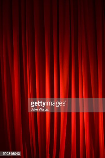 Spot-lighted Red stage curtain
