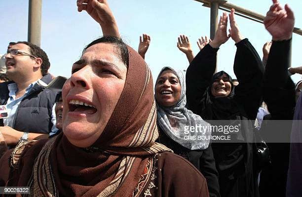 Spouses and relatives of crewmembers aboard Egyptian fishing ships Momtaz I and Ahmad Samara react as they ships arrive at Ataka port 170 kms...