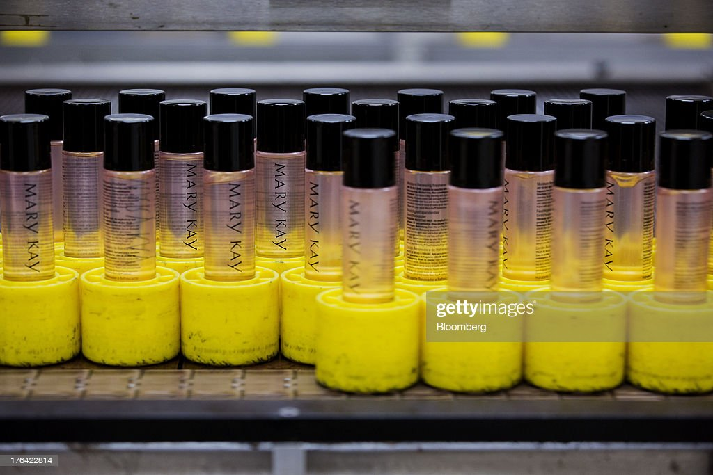 Spray bottles move through an automated filling machine at the Mary Kay Inc. manufacturing facility in Dallas, Texas, U.S., on Tuesday, Aug. 6, 2013. About 350,000 Mary Kay businesses were started globally in the past year, including 90,000 in the first quarter of 2013, according to a company press release. Photographer: T.J. Kirkpatrick/Bloomberg via Getty Images