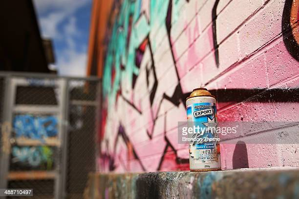 A spray can sits atop a wall strewn with graffiti on May 8 2014 in Sydney Australia The Grafitti Control Amendment Act passed in the NSW legislative...