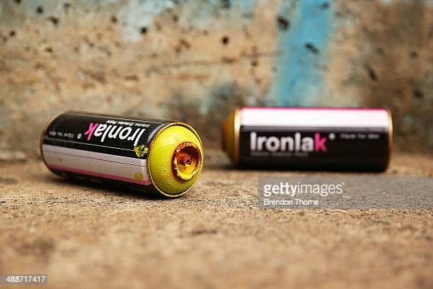 Spray cans sit next to a wall strewn with graffiti on May 8 2014 in Sydney Australia The Grafitti Control Amendment Act passed in the NSW legislative...