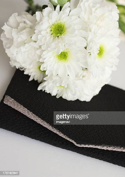 Spray mums and a crape wrapper (Mourning image)