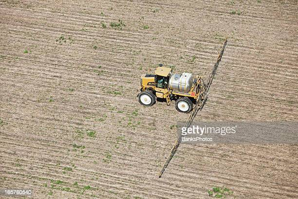 Sprayer Applying Herbicide to Corn Field