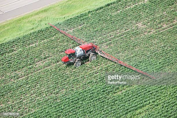 Sprayer Applying Liquid Nitrogen Fertilizer to Corn Field