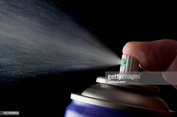 Spraying aerosol can isolated in black