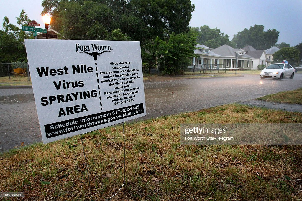 Spraying for mosquitoes in Fort Worth, Texas, will proceed dispite heavy rain that moved into the area on Friday, August 17, 2012, in a bid to curb an outbreak of West Nile virus.